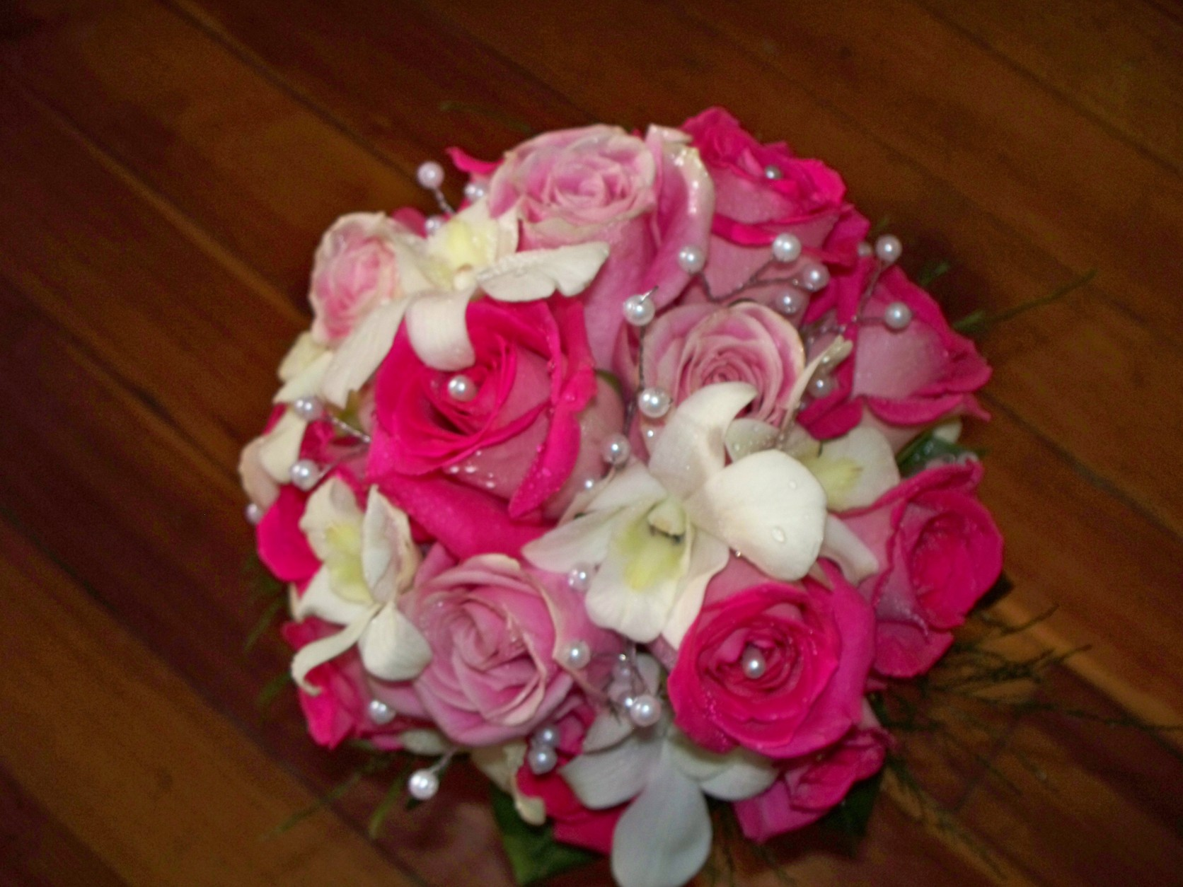1315 HOT PINK & LT PINK ROSES W/ WHITE DENDROBIAN ORCHIDS & PEARLS