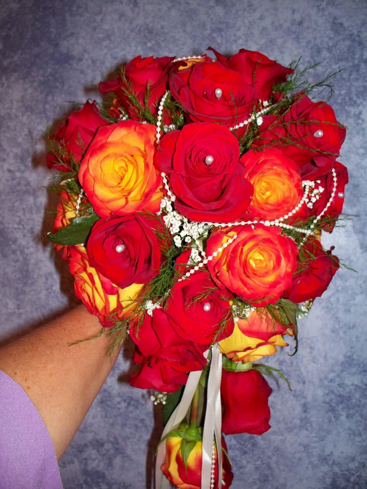 CASCADING BOUQUET WITH RED/ORANGE ROSES W/PEARL ACCENTS