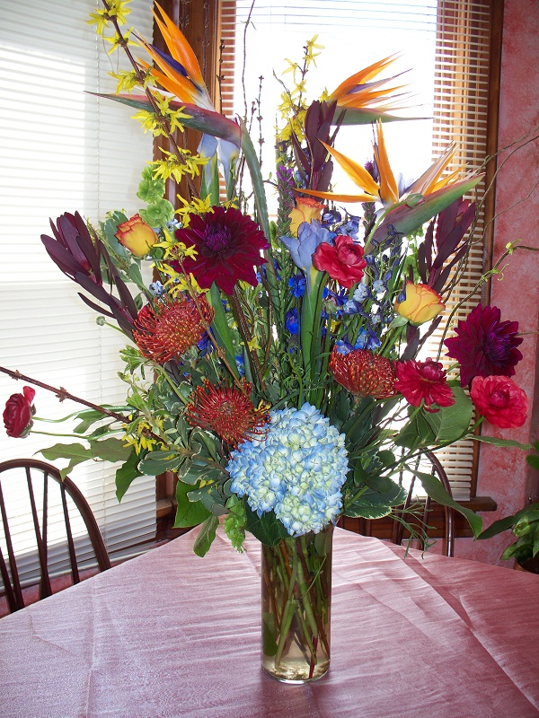 2046 EXOTIC ARRANGEMENT ORANGE,BURGANDY & BLUE